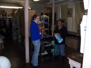 A couple of our food pantry volunteeers prepare bags of groceries for distribution